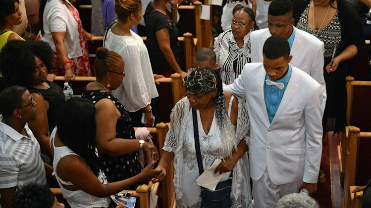 Gwen Carr mother of Eric Garner is consoled by mourners at the at the funeral service for her son Eric Garner at Bethel Baptist Church in Brooklyn New York
