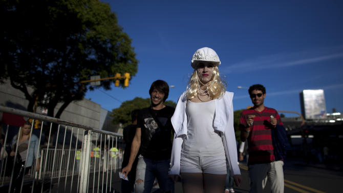 """Lady Gaga fans gather outside the stadium where the U.S. pop star will perform a concert, in Buenos Aires, Argentina, Friday, Nov. 16, 2012. The Latin American leg of her, """"Born This Way Ball Tour,"""" is coming to an end but not before stopping in Chile, Peru and Paraguay,. (AP Photo/Natacha Pisarenko)"""