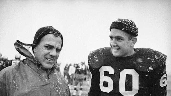 In this Nov. 20, 1964, file photo, Notre Dame coach Ara Parseghian, left, and team captain James Carroll are shown during a practice session in South Bend. Notre Dame was at rock bottom when Ara Parseghian took over 50 years ago. The Irish finished the season 2-7 in 1963 and the only thing that kept them from matching the worst record in school history set in 1956 was the game against Iowa was cancelled because of the assassination of John Kennedy
