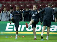 England's defender Ashley Cole (left) and forward Wayne Rooney (centre) take part in a trainning session on October 15 one day before the FIFA 2014 World Cup qualifying Group H match between Poland and England at the National Stadium in Warsaw