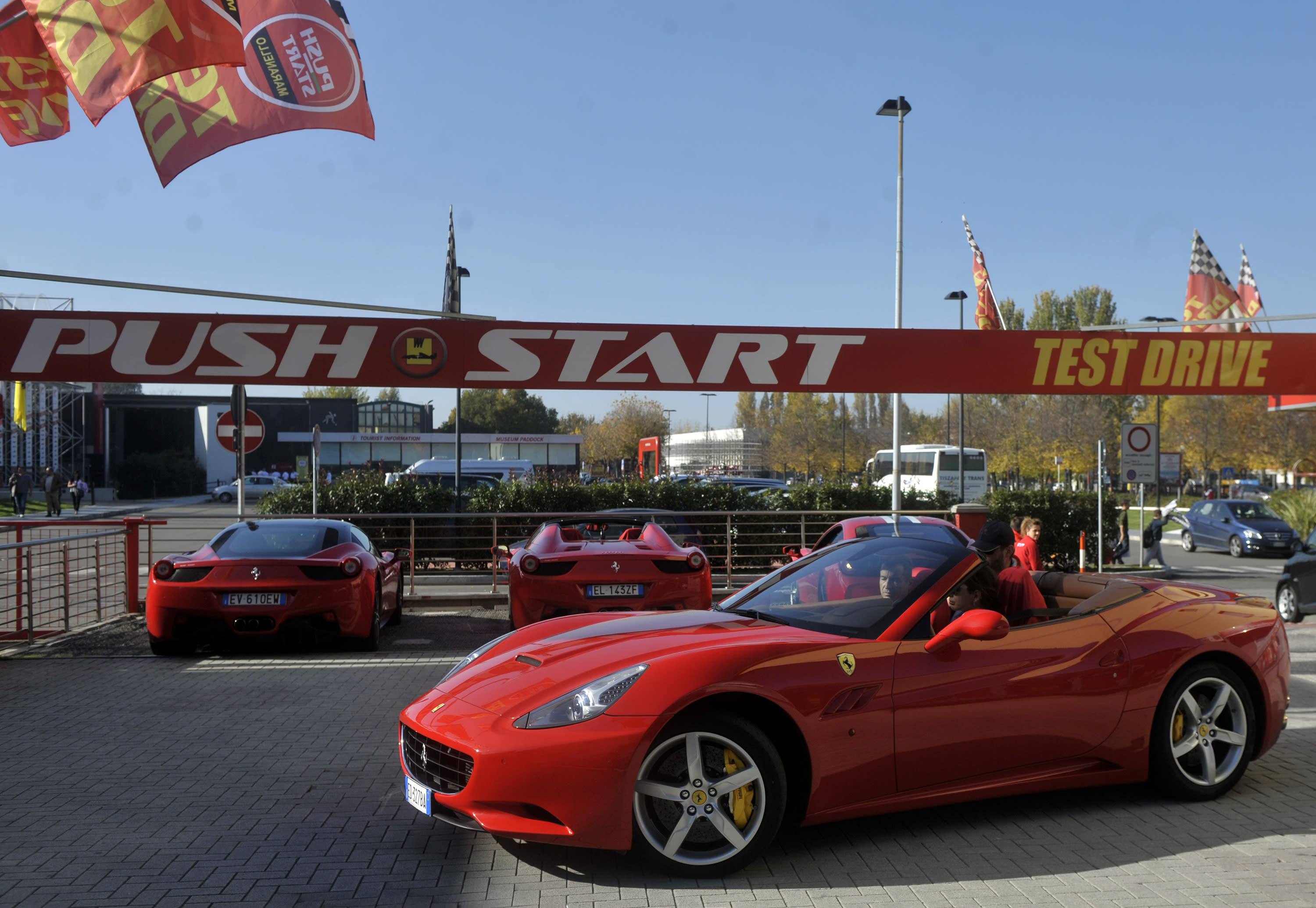 Ferrari hometown overwhelmed by roar of test-driving fans