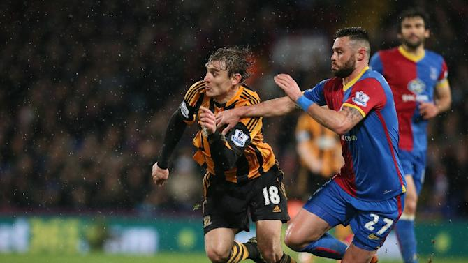 Crystal Palace's Damien Delaney, right goes for the ball with Hull's Nikica Jelavic during their English Premier League soccer match between  Crystal Palace and Hull City at Selhurst Park stadium in London Tuesday, Jan. 28, 2014