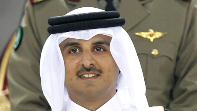 FILE - In this Saturday, Jan. 29, 2011, file photo, Qatar's crown prince, Sheik Tamim bin Hamad Al Thani, attends the AFC Asian Cup final soccer match between Japan and Australia in Doha, Qatar. Qatar's 61-year-old emir, Sheik Hamad bin Khalifa Al Thani, said Tuesday, June 25, 2013, he has transferred power to the 33-year-old crown prince in an anticipated move that puts a new generation in charge of the Gulf nation's vast energy wealth and rising political influence. (AP Photo/Hassan Ammar, File)