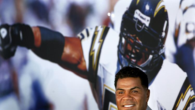 FILE - In this Aug. 14, 2006, file photo, former San Diego Chargers football player Junior Seau smiles during a news conference announcing his retirement from pro football in San Diego. Seau, a former NFL star, was found dead at his home in Oceanside, Calif.  He was 43. (AP Photo/Sandy Huffaker, File)