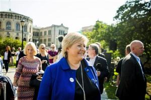 Norway's main opposition leader Erna Solberg of Hoyre smiles as she greets the media in front of the Parliament building in Oslo