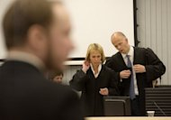 Norwegian right-wing extremist Anders Behring Breivik stands in court on Thursday as prosecutors Inga Bejer Engh and Svein Holden prepare to present their closing arguments against him in the courtroom in Oslo. Breivik, who killed 77 people in Norway last July, should be locked up in a psychiatric ward instead of prison, the prosecution said Thursday