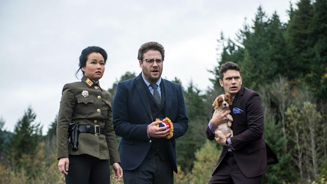 """This photo provided by Columbia Pictures - Sony shows, from left, Diana Bang, as Sook, Seth Rogen, as Aaron, and James Franco, as Dave, in Columbia Pictures' """"The Interview."""" (AP Photo/Columbia Pictures - Sony, Ed Araquel)"""