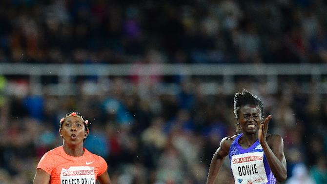 Shelly-Ann Fraser-Pryce of Jamaica (L) crosses the finish line to win over Tori Bowie of the US during the 100m Women's event of the IAAF Diamond League Bauhaus Athletics meeting at the Stockholm Olympic Stadium on July 30, 2015
