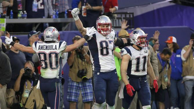 New England Patriots tight end Gronkowski celebrates his second quarter touchdown against the Seattle Seahawks with teammates Edelman and Amendola during the NFL Super Bowl XLIX football game in Glendale