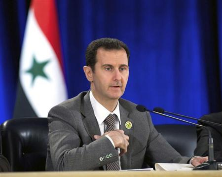 Handout of al-Assad speaking during his meeting with the leadership al-Baath party of Damascus countryside,in Damascus
