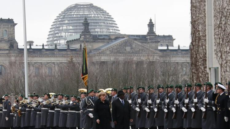 German Chancellor Merkel and Mali's President Keita review a guard of honour during a welcome ceremony at the Chancellery in Berlin