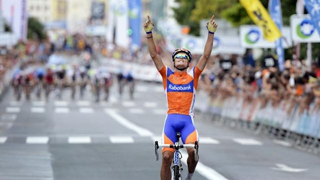 Sanchez raises his arms in victory as he crosses the finish line in San Sebastian (Reuters)