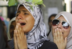 Egyptian women grieve during the funeral of opponents …