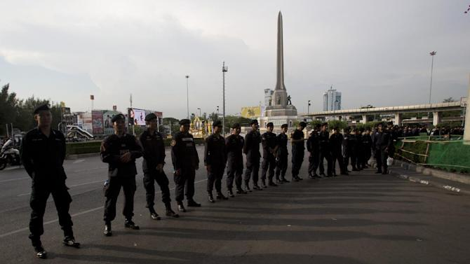 Thai riot police stand guard near Victory Monument in Bangkok, Thailand, Friday, May 30, 2014. An anti-coup activist called Friday for a weekend rally to defy the military government's ban on demonstrations, urging those opposed to the takeover to wear masks and be ready for cat-and-mouse chases with soldiers in the capital. (AP Photo/Sakchai Lalit)