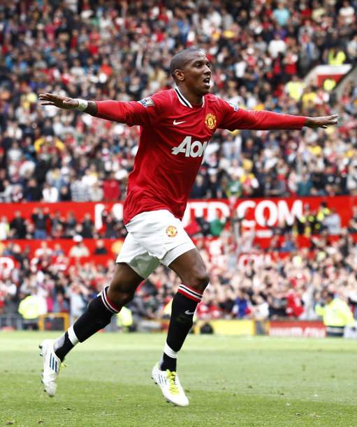 Manchester United's Ashley Young celebrates after scoring a goal against Arsenal during their English Premier League soccer match at Old Trafford, Manchester, England, Sunday Aug. 28, 2011. (AP Photo/Jon Super)