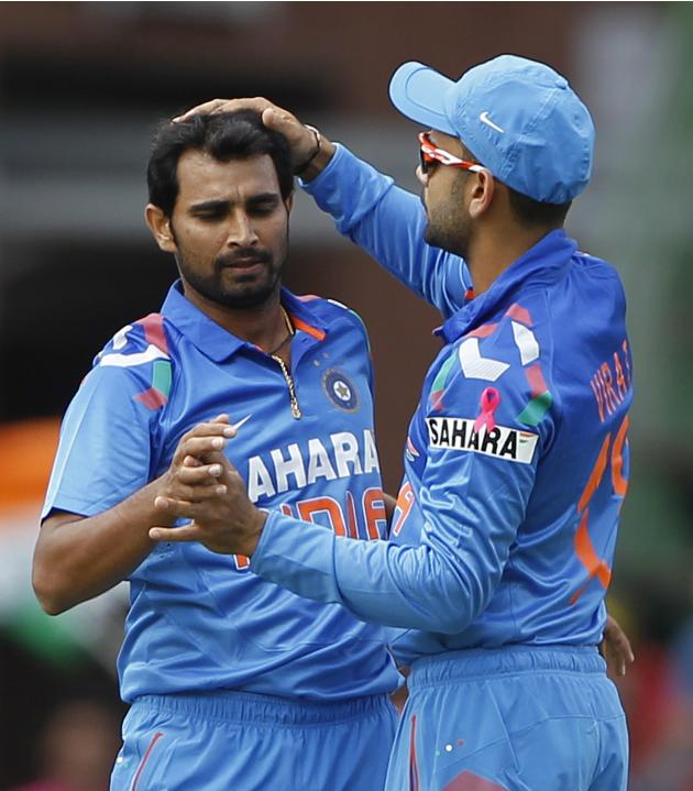 India's Shami is congratulated by Kohli after Shami bowled out South Africa's Kallis during their first ODI in Johannesburg