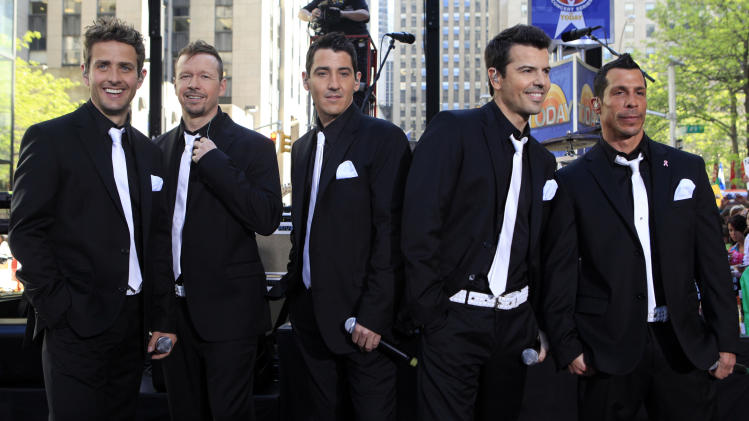 "FILE - This May 8, 2009 file photo shows members of New Kids on the Block, from left, Joey McIntyre, Donnie Wahlberg, Jonathan Knight, Jordan Knight, and Danny Wood on the NBC ""Today"" television program in New York. New Kids On the Block, 98 Degrees and Boyz II Men are teaming up for a summer tour. The groups announced ""The Package Tour"" on Tuesday, Jan. 23, 2013, on the daytime program, ""The View.""  (AP Photo/Richard Drew)"