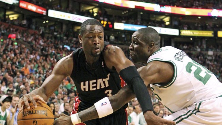 Miami Heat's Dwyane Wade, left, struggles to get around Boston Celtics' Mickael Pietrus in the second quarter of Game 4 in their NBA basketball Eastern Conference finals playoffs series in Boston, Sunday, June 3, 2012. (AP Photo/The Miami Herald, Al Diaz)  MAGS OUT