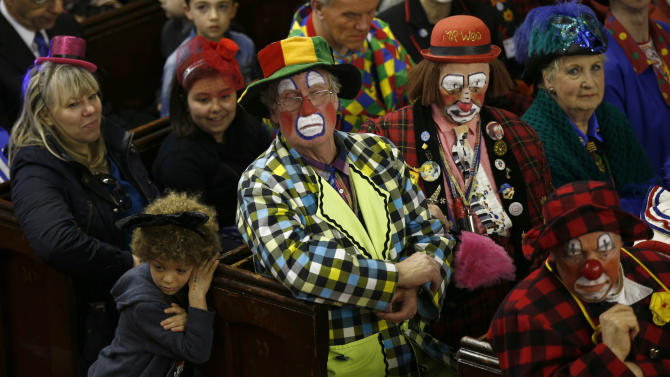 Clowns and members of the public sit in the pews of the All Saints Church during the Grimaldi clown service in Dalston, north London
