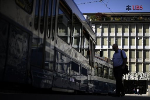 <p>A man waits for the tram in front of the building of Swiss banking giant UBS in Zurich in 2011. With their long-cherished secrecy practices increasingly under attack, Swiss banks are scrambling for a new way to attract wealthy foreign clients.</p>