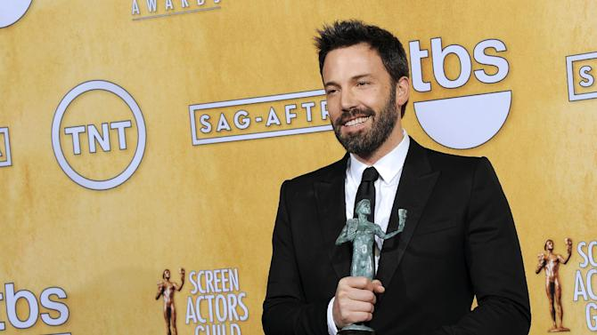 "FILE - In this Sunday, Jan. 27, 2013 file photo, actor Ben Affleck poses backstage with the award for best cast in a motion picture for ""Argo"" at the 19th Annual Screen Actors Guild Awards at the Shrine Auditorium in Los Angeles. A best-picture win at the upcoming Oscars could be viewed as righting a wrong after Affleck inexplicably missed out on a best-director nomination. (Photo by Chris Pizzello/Invision/AP, File)"