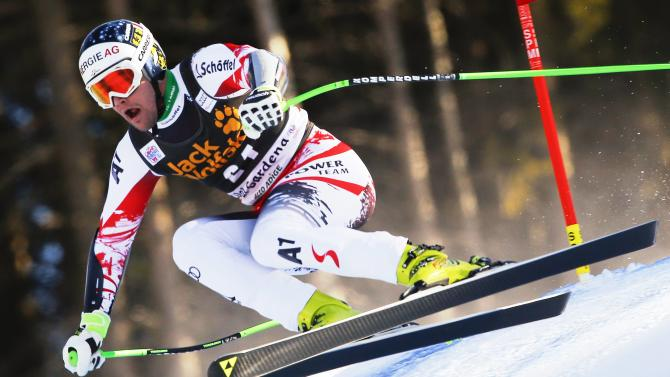 Kriechmayrk of Austria clears a gate during the men's World Cup Super-G skiing race in Val Gardena