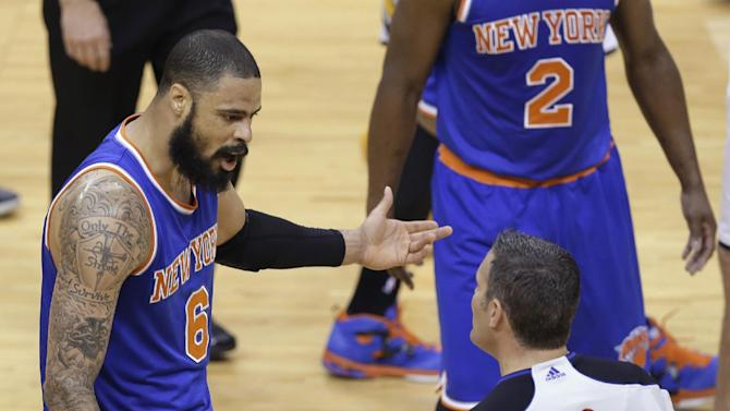 New York Knicks center Tyson Chandler, left, questions referee Monty McCutchen after receiving a technical foul during the first half of Game 4 against the Indiana Pacers in the Eastern Conference semifinal NBA basketball playoff series, in Indianapolis on Tuesday, May 14, 2013. (AP Photo/Michael Conroy)