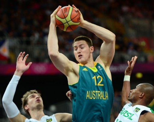 Australian centre Aron Baynes (centre) lines up a shot, but it's not enough as Brazil wins 75-71