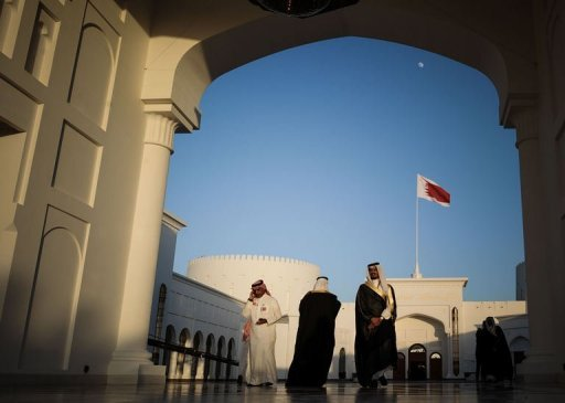 Men walk along the corridor at the Sakhir Palace in Manama, on December 24, 2012, as delegates attend the annual Gulf Cooperation Council (GCC) summit. Iran on Wednesday rejected as &quot;baseless&quot; allegations by Gulf Arab states that Tehran is interfering in their internal affairs, the official IRNA news agency reported