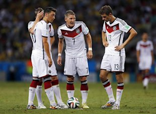 Mesut Ozil, Toni Kroos, Miroslav Klose and Thomas Mueller contemplate a free kick during Germany's draw with Ghana. (AP)