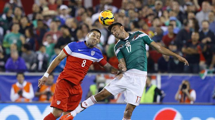 United States' Clint Dempsey fight for the ball against Mexico's Jesus Eduardo Zavala during an international friendly soccer match, Wednesday, April 2, 2014, in Glendale, Ariz