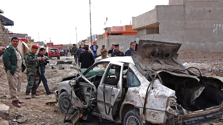 FILE - in this file photo taken on Jan. 16, 2012 Iraqi security forces inspect the scene of a car bomb attack outside the northern city of Mosul, 225 miles (360 kilometers) northwest of Baghdad, Iraq. Al-Qaida's Iraq arm is gaining strength in the restive northern city of Mosul, reviving its fundraising efforts through gangland-style shakedowns, feeding off anti-government anger and increasingly carrying out attacks with impunity. It is a worrying development for Iraq's third-largest city, one of its main gateways to Syria, as voters prepare to cast ballots for local leaders and al-Qaida makes a push to establish itself as a dominant force among the rebels fighting to topple the Syrian regime. (AP Photo, File)