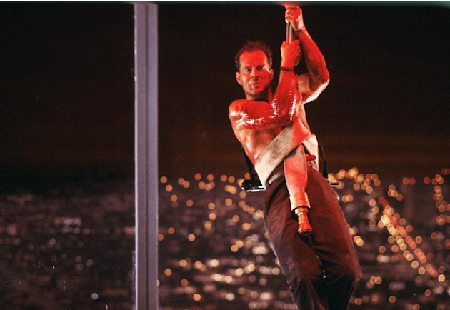 "This publicity photo released by Twentieth Century Fox Home Entertainment shows Bruce Willis in a scene from the 1988 film, ""Die Hard."" The ""Die Hard"" 25th Anniversary Collection Blu-ray released on J"