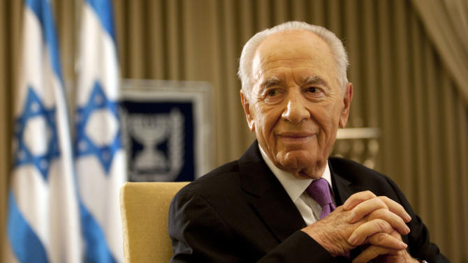 """Israel's President Shimon Peres, during an interview with the Associated Press in his residence in Jerusalem, Thursday, June 16 , 2011. Israeli President Shimon Peres urged a resumption of Middle East peace talks Thursday, dismissing the Palestinians' plan to instead ask the United Nations for recognition as """"an illusion"""" and arguing that a peace deal, despite widespread skepticism on both sides was possible within months.  """"In a strange way the differences are rather psychological than material,"""" the 87-year-old head of state and Nobel laureate said in an interview with The Associated Press. (AP Photo/Sebastian Scheiner)"""