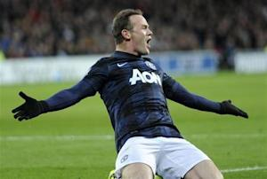 Manchester United's Wayne Rooney celebrates scoring a goal against Cardiff City during their English Premier League soccer match at Cardiff City Stadium in Cardiff,