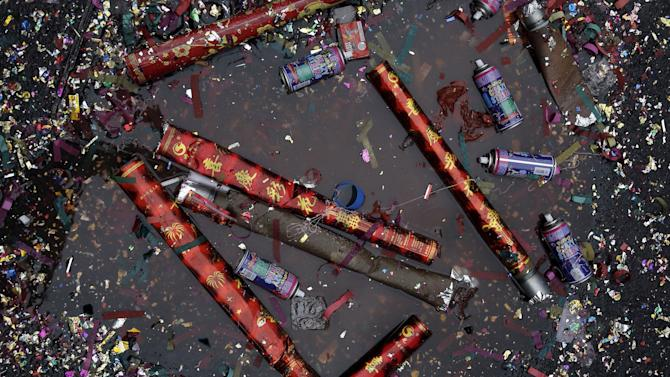 Confetti and spray cans litter the ground as people celebrate the Chinese Lunar New Year in Manhattan's Chinatown in New York