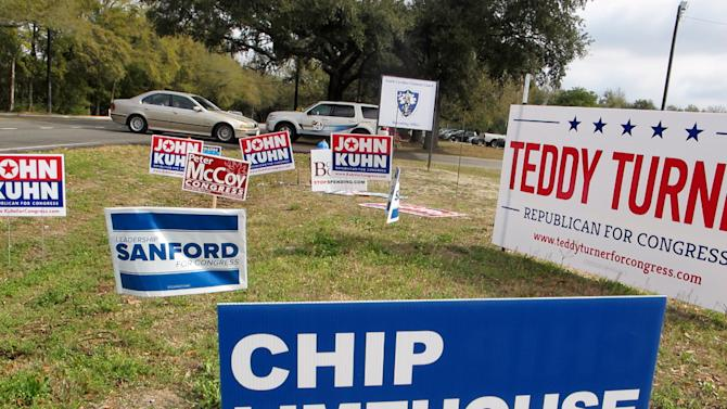 Campaign signs line the curb outside a polling place in Mount Pleasant, S.C., on Tuesday, March 19, 2013. Former South Carolina Gov. Mark Sanford, trying to make a political comeback, is one of 16 Republicans running Tuesday in the GOP primary in a special election to fill South Carolina's vacant 1st Congressional District seat.   (AP Photo/Bruce Smith).