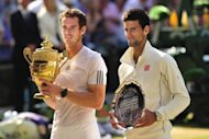 Britain's Andy Murray (L) poses with the winner's trophy next to runner up Serbia's Novak Djokovic during the presentation after the Wimbledon men's singles final at the All England Club in Wimbledon, southwest London, on July 7, 2013. Djokovic and Murray have now contested three of the last four Grand Slam finals