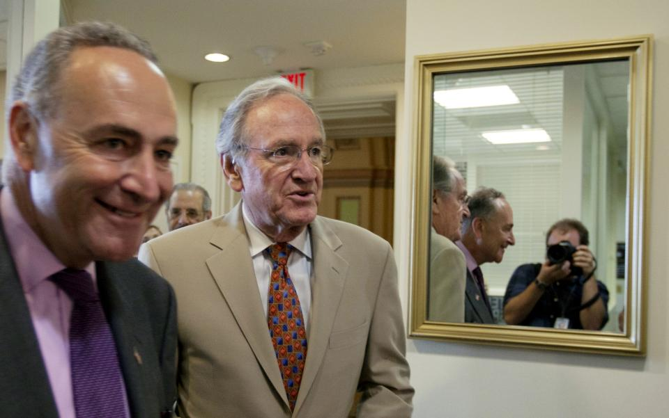 "Sen. Charles Schumer, left, and D-N.Y., Sen. Tom Harkin, D-Iowa,  arrive for a news conference to denounce the House Republicans ""Cut, Cap, and Balance Act"" on Wednesday, July 20, 2011, in Washington. (AP Photo/Carolyn Kaster)"
