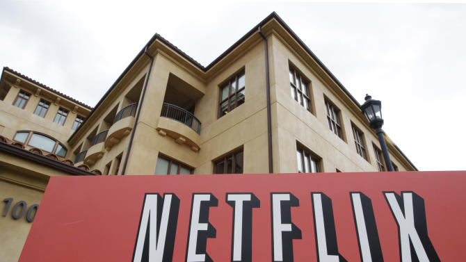 FILE - In this Oct. 10, 2011 file photo, the exterior of Netflix headquarters is seen in Los Gatos, Calif. Netflix's third-quarter earnings rose 65 percent even though the video subscription service suffered the biggest customer losses in its history, according to earnings reports released Monday, Oct. 24, 2011. (AP Photo/Paul Sakuma, File)