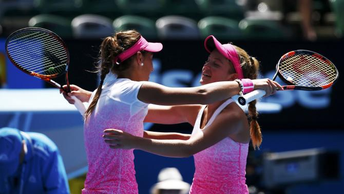 Mihalikova of Slovakia hugs Swan of Britain after winning their junior girls' singles final match at the Australian Open 2015 tennis tournament in Melbourne