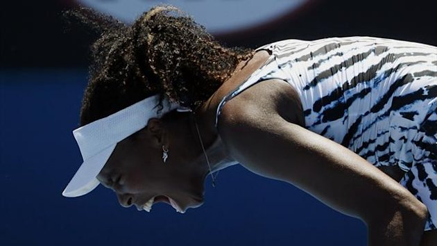 Venus Williams of the U.S. reacts during her women's singles match against Ekaterina Makarova of Russia at the Australian Open 2014 tennis tournament in Melbourne January 13, 2014. (Reuters)