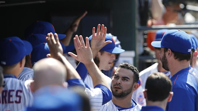 Teammates congratulate New York Mets reliever Alex Torres, center, after he pitched the Mets out of a base-loaded jam in the sixth inning of a baseball game against the Washington Nationals in New York, Sunday, May 3, 2015. (AP Photo/Kathy Willens)