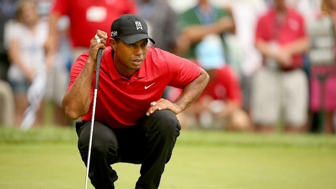 Tiger Woods lines up a putt on the 11th hole during the final round of the Greenbrier Classic on July 5, 2015 in White Sulphur Springs, West Virginia