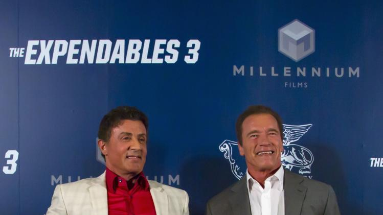 "Cast members Sylvester Stallone and Arnold Schwarzenegger pose as they arrive on red carpet for the special screening of ""The Expendables 3"" in Macau"