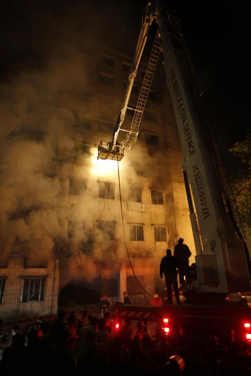 Bangladeshi firefighters try to extinguish a fire at the nine-storey Tazreen Fashion plant in Savar, Bangladesh, on November 24, 2012