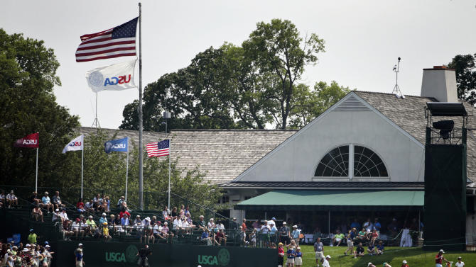Fans watch golfers practice putting on the 18th hole during a practice round for the U.S. Women's Open golf tournament at Lancaster Country Club, Tuesday, July 7, 2015, in Lancaster, Pa. (AP Photo/Frank Franklin II)