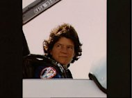 Astronaut Sally Ride is seated in the cockpit of a T-38 aircraft in preparation to depart for the Kennedy Space Center ahead of the STS-41G mission.