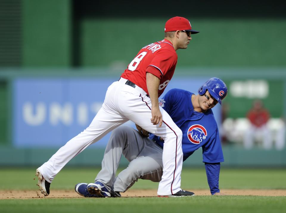Chicago Cubs first baseman Anthony Rizzo, back, gets caught in a rundown, while attempting to steal second, by Washington Nationals second baseman Danny Espinosa during the fifth inning of a baseball game, Saturday, May 11, 2013, in Washington. (AP Photo/Nick Wass)