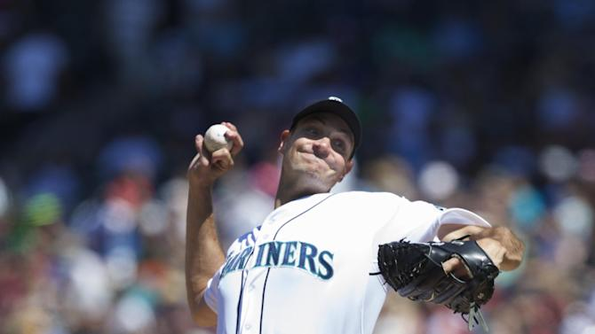 Young pitches Mariners to 4-3 win over Orioles